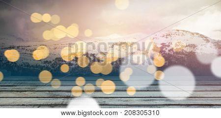 Full frame shot of weathered plank against scenic view of snow capped mountain