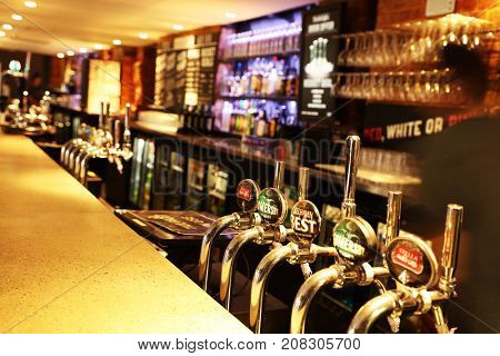 LONDON, UK - SEPTEMBER 21, 2017: Draft Beer in a traditional english pub