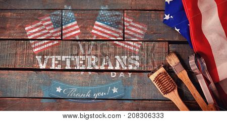 Logo for veterans day in america  against basting brush and tong with american flag on table