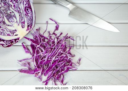 choped Red Cabbage on Wooden Cutting Board with knife