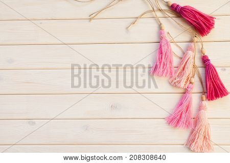 Pink Brush For Curtains. Background Of White Wood.