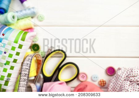 Accessories For Sewing Lie On A White Background. Measuring Tape, Thread, Fabric, Needle Bar And Nee