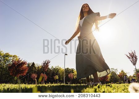 Joyful and happy woman outdoor,enjoy life,summer, green lawn