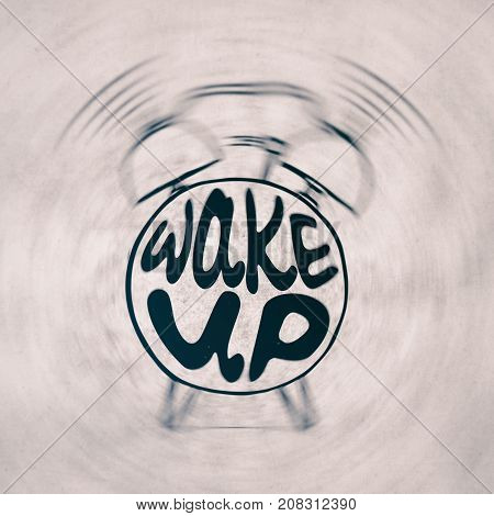 Hand draw Alarm clock illustration with lettering about wake up. Waking up reminder in sketched alarm clock.with light texture.