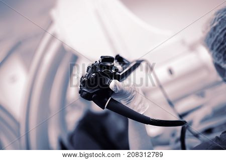 Endoscopy probe in the doctor's hand during procedure.