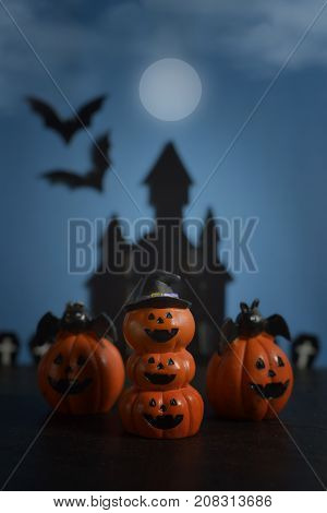 Halloween pumpkins jack-o-lantern on dark blue background. Halloween pumpkin background. Halloween. jack-o-lantern. Halloween jack-o-lantern. Happy Halloween.
