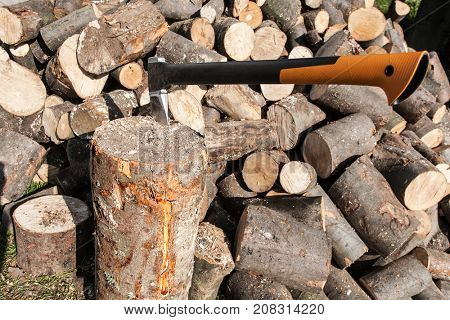 Cutting firewood with an ax.