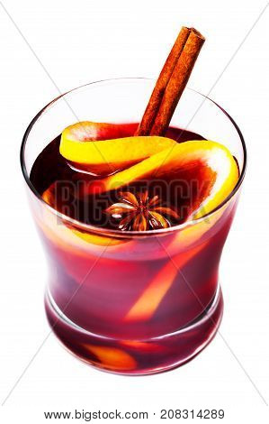Christmas mulled wine isolated on white background. Red Hot wine or gluhwein with spices cinnamon sticks and orange slices. Traditional drink on winter holiday