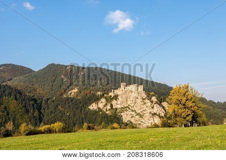 Ruins Of Strecno Castle In Autumn Landscape Under Blue Sky