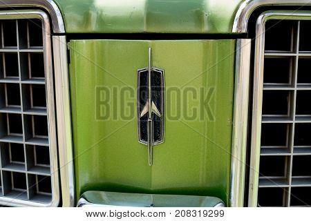 Oldsmobile Cutlass Supreme Emblem On Green Backgrownd