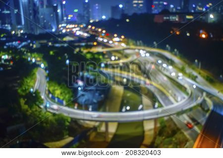 Blur Image of busy highway at the city during night