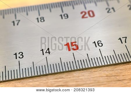A fragment of metal measuring ruler with centimeter and millimeter divisions.
