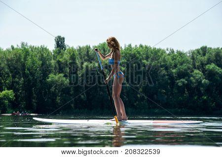 Beautiful Girl On Sup Board