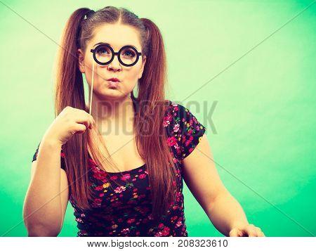 Happy Teenage Woman Holding Fake Eyeglasses On Stick