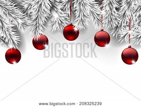 Fir branches decorated with Christmas baubles on white background with space for text.
