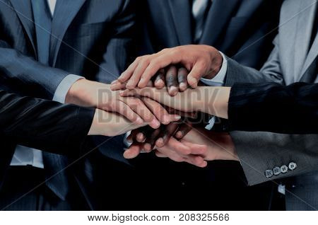 group of workers with their hands together