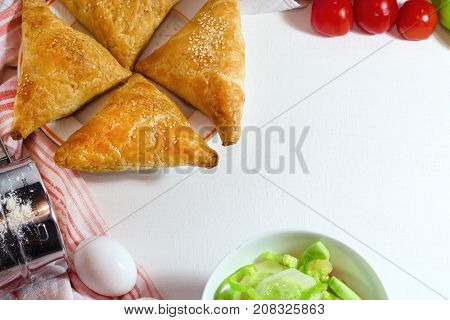 stuffed vegetable or veg puff or puf or samosa famous indian snack menu served with hot tea selective focus