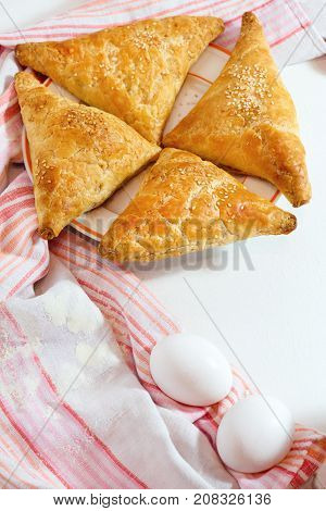 Homemade Cheese Puff Pastries On White Wooden Background
