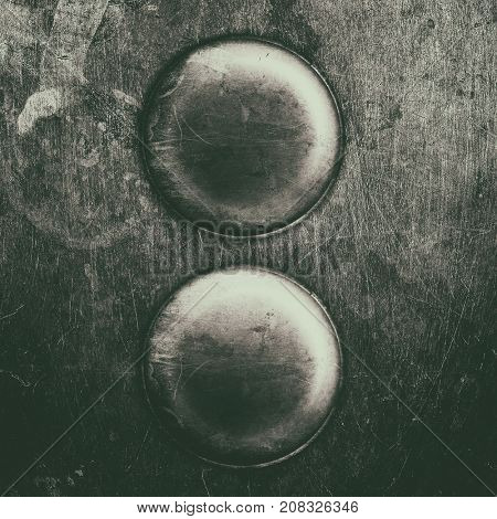 two old worn metal buttons texture