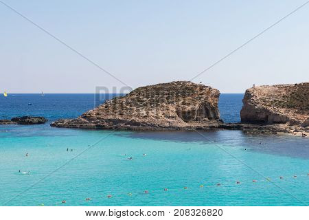 Stunning tropical Mediterranean sea, crystal clear azure turquoise blue waters of the Blue Lagoon on the small holiday destination island of Comino, Malta, June 2017