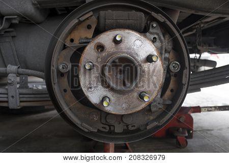Close up of old hub wheel car. Rust on hub wheel. Rear wheel.