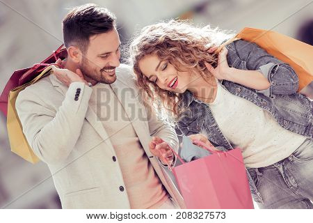 Happy young couple with shopping bags.Sale,consumerism and people concept