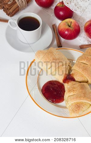 Continental breakfast with fresh croissant apple honey cinnamon and black coffee on a table. Top view copy space for your text