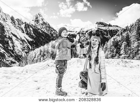 Happy Mother And Daughter Travellers In Winter Outdoors Playing