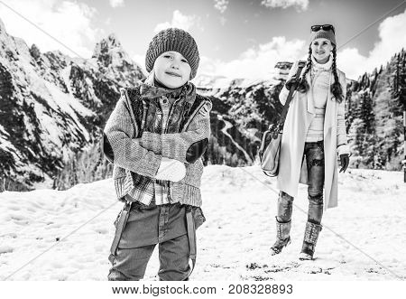 Mother And Daughter Tourists Against Mountain Landscape