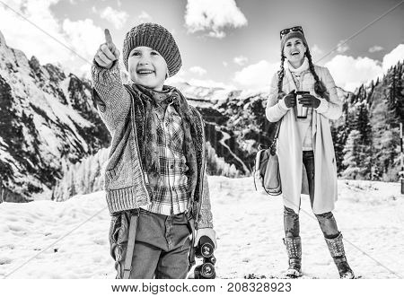 Mother And Child Tourists With Binoculars Pointing At Something