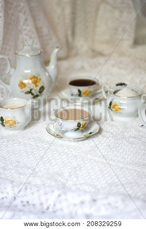 Set of breaking time coffee with sugar and milk on white table