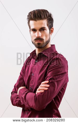 Studio shot portrait of young angry businessman.