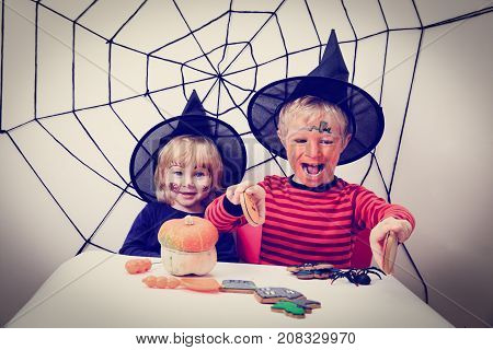 little girl and boy prepare for Halloween party, Halloween celebration