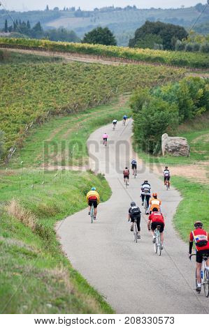 Gaiole in Chianti Tuscany Italy - October 1 2017: Unidentified participant of L'Eroica a historic cycling event for owners of vintage bicycles played on white gravel roads of Chianti