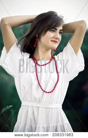 Beautiful Woman. Young Pretty Woman Wearing A White Dress In A P