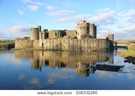 Caerphilly Castle reflected in the lake, Wales