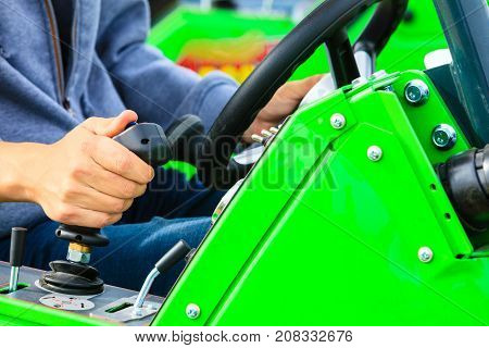 Man Operating Big Industrial Agricultural Machine