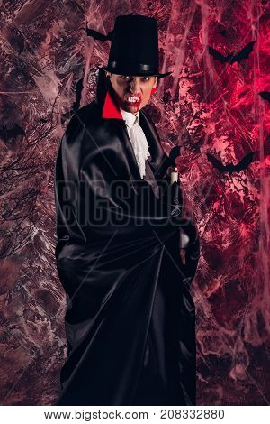 handsome man dressed in a Dracula costume for Halloween. attractive vampire