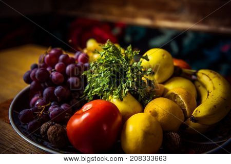 Juicy Fruits And Vegetables On A Wooden Table
