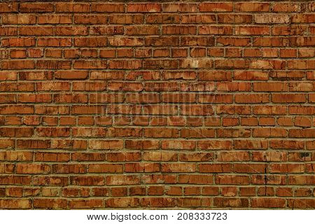 Classic brown brick wall. Brick background. Brick texture. Brown brick background. Brown brick. Firebrick background. Grunge brick wall. Brickwork.