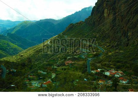 A beautiful wild mountain scape and curves winding road high view in green mountains in Gran Canaria Spain.