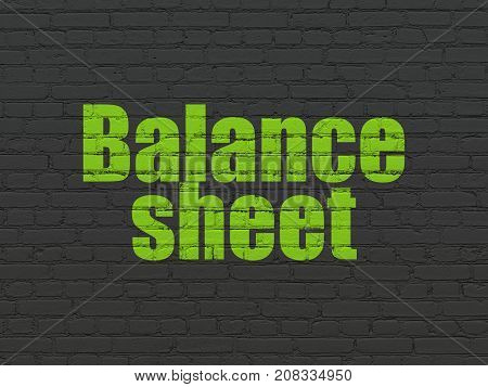 Banking concept: Painted green text Balance Sheet on Black Brick wall background