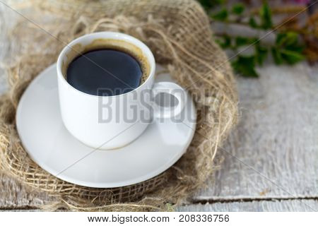 expresso coffee on wooden table background vintage tone