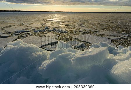 Pile of Ice on the beach in sunset time