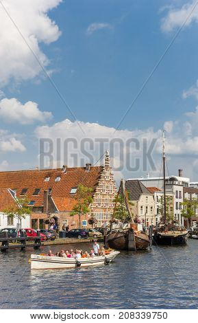 LEIDEN, NETHERLANDS - SEPTEMBER 03, 2017: Tourists at a boat tour in the canals of Leiden Holland