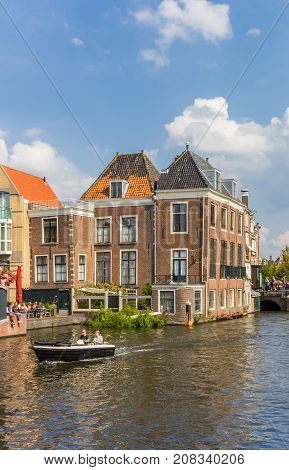 LEIDEN, NETHERLANDS - SEPTEMBER 03, 2017: Small boat in the historic canals of Leiden Holland