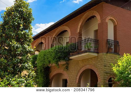 Pienza, Italy - May 27, 2017: Traditional house in the small magical and old village of Pienza, Val D'Orcia Tuscany - Italy