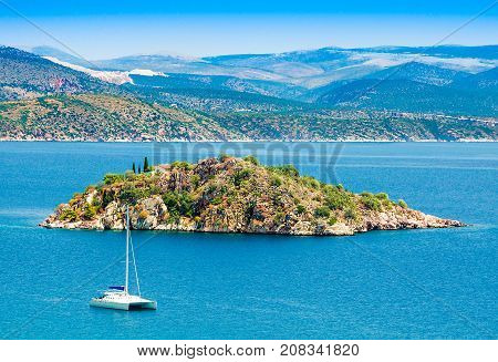GreecePeloponesseTolo town near Nafplion city. View of the sea with a small island and a white catamaran
