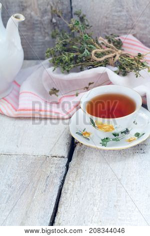 Herbal Tea With Thyme On Rustic Background