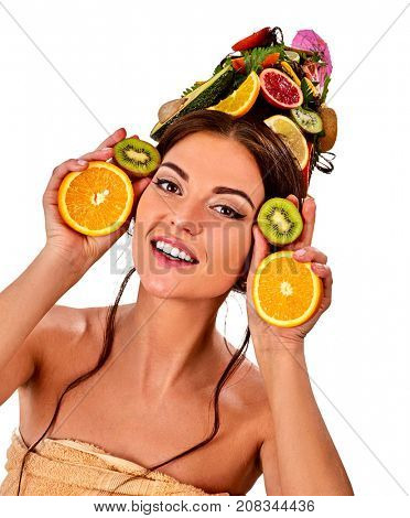 Hair mask from fresh fruits on woman head. Girl with beautiful face and hairstyle hold halves of orange for skin and body therapy. Female bare shoulders. Acceleration of hair growth.